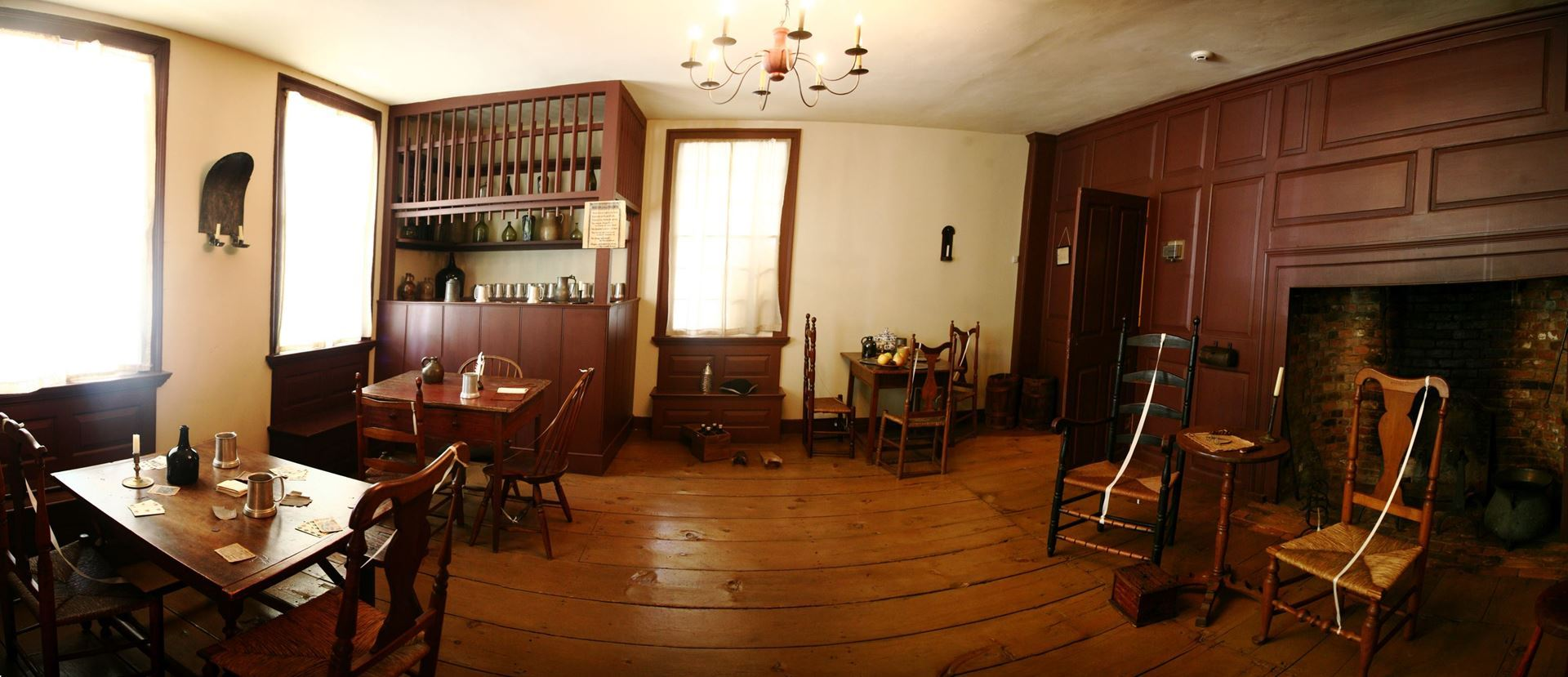 interior image of the Square House Inn, an 18th century building with colonial style furniture and large fireplace